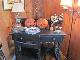 desk, chair, lamps. These two jack-o-lanterns are antiques.