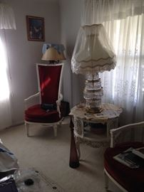 ONE OF 2 MATCHING VELVET KINGS CHAIRS, LARGE TABLE PRISM LAMP SITTING ON A BEAUTIFUL MARBLE TOP TABLE.
