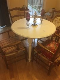 Round wooden table and 4 chairs, candle holders