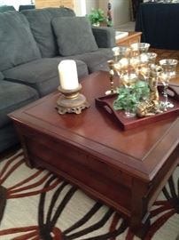 Two tiered square coffee table; 3-cushion sofa has a matching love seat