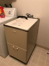 Laundry room wash sink.