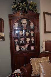 Beautiful Antique Corner Cabinet just notice all of the Fabulous Hull Pottery Displayed here!!!