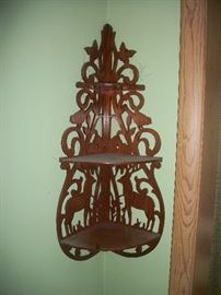 wood corner shelf carved with deer