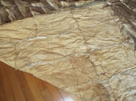 back of Hand made rabbit pelt rug 8ft by9ft. Believe to be American Indian made