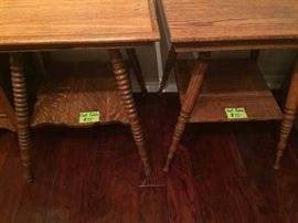 Bottom shelves of the two antique oak side tables