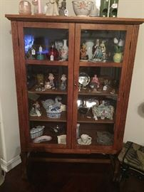 Antique oak curio cabinet with glass fronts and sides