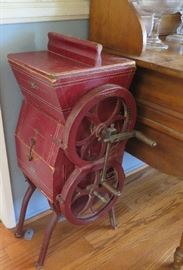 Floor antique butter churn with side crank.