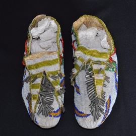 Sioux beaded moccasins on parfleche c. 1890-1900