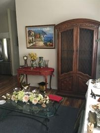 large display cabinet, curio. red distressed look side table, glass wrought iron coffee table