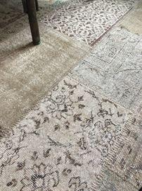 Detail of large patchwork rug.