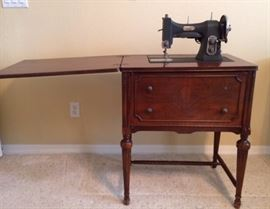 White Sewing Machine in Wood Cabinet