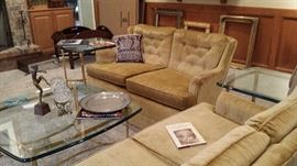 Pair of loveseats and matching brass and glass coffee and two lamp tables.