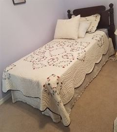 Twin bed with wood headboard