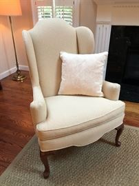 Elegant Upholstered Arm Chair with Cabriole Legs - Natural Fiber Rug Underneath