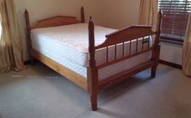 Full-size antique bed and beautiful bird's-eye maple. Mattress and springs like new. Priced at only $250.