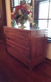 Antique chest from the 1800s. With marble top. Priced at $225.