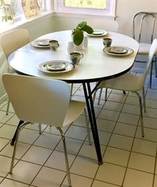 Mid-century kitchen table and four contemporary chairs.