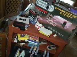 Nintendo NES in box complete with manuals and many games in box with manuals. All in excellent condition