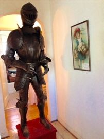 Suit of Armor used in a Vincent Price Production.  Suits of Armor were made to display in hallways of large estates and quite often used in movie productions such as this one.