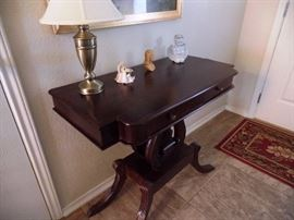 Gleaming antique lamp table