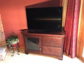 Large flat screen TV with entertainment center cabinet