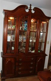 Beautiful mahogany Queen Anne China Cabinet with lights and glass doors. Lots of storage.