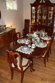 Queen Anne table with the 6 chairs with white fabric.