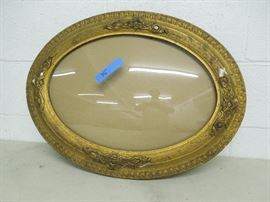 Antique picture frame with curved glass