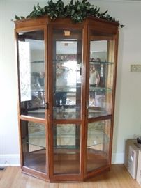 Lighted glass front curio cabinet