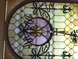 Amazing arched antique stained glass window