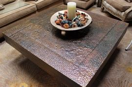 Hand hammered metal clad coffee table.