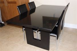 Custom kitchen table and four leather chairs.