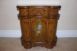 Decorative entry cabinet.