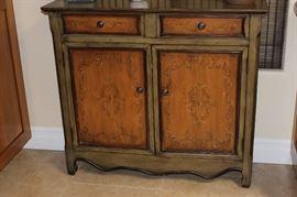 Decorative narrow cabinet.