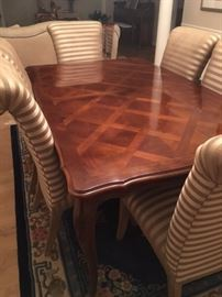 Drexel Heritage dining room table with six fabric chairs.  Two leaves and custom pad to fit curves and contour of table edge.