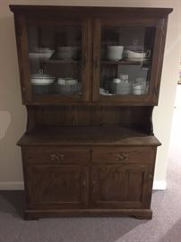 Two Piece Oak hutch with display case on top of base unit