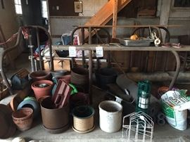various pots, wire fence,