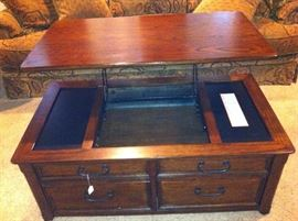 Ashley coffee table with top that raises and lowers
