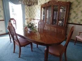 Bernhardt Dining room table w/2 leaves, pads, 6 cane back chairs, buffet and matching lighted China Cabinet