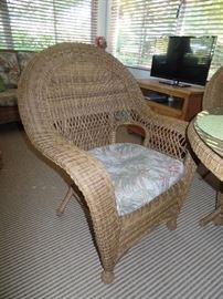 Like new wicker glass top table and 4 chairs