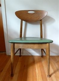 Mid Century Modern side chair with green vinyl seat and oval cut-out back..