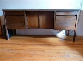 Mid Century Modern credenza by National Office Furniture. two shallow drawers, 2 file drawers, center storage section with sliding doors.   Wood and laminate.