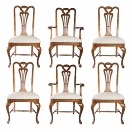 Queen Anne Style Dining Chairs: A set of six Queen Anne style dining chairs. The chairs features oak frames with carved back splats with a heart shape to the top and cream upholstered seats. The chairs rest on cabriole style front legs with turned spacers. The set includes four side chairs with two arm chairs.