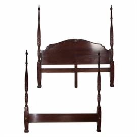 """Lexington Furniture King Sized Bed Frame: A king sized four poster bed frame by Lexington Furniture. The mahogany stained bed frame features carved foliate detailing throughout the posters and to the center of the headboard. The frame includes a headboard, footboard, side rails, and slats. The piece is marked to the back """"Lexington, Plantation, Made in USA."""""""