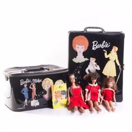Vintage Barbie Dolls and Accessories: A collection of vintage Barbie dolls and accessories. The collection includes two Midge dolls and one Skipper. The dolls are marked 1962 and 1963. The collection comes with clothing accessories, a travel tote and a wardrobe case.