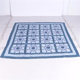 "Hand Quilted ""Eight Pointed Star"" Quilt: A hand-quilted Eight Pointed Star quilt. This quilt, in shades of blue printed and solid fabrics features four by four panels of pieced eight pointed stars in a blue grid with hand quilting. This piece us not marked by a maker."