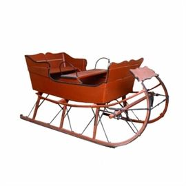 19th Century Horse Drawn Wooden Sleigh: A charming antique wooden horse sleigh with scalloped shaped edge and red barn and black painted finish. The sleigh seats four with two wooden bench seats and has large curved wooden runners trimmed with metal bands. The wood structure is supported with wrought iron bracing throughout. Circa 1900.  Preview is available for this item Tuesday through Friday 10 am – 4 pm and Saturday 10 am – 5 pm at the Warren County History Center, 105 S. Broadway, Lebanon, Ohio 45036.  This item is local pick up only. Pick up is Tuesday, October 17th from 9 am – 12 pm at the Warren County History Center, 105 S. Broadway, Lebanon, Ohio 45036.