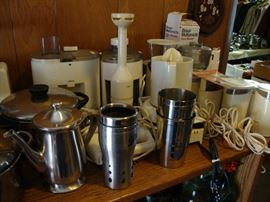 Restaurant quality stainless steel prep, bakeware, and serving pieces; small appliances including immersion blender, coffee grinders