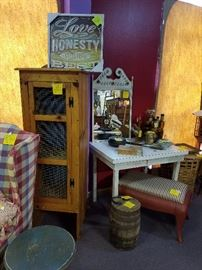 Cast iron stove base made into bench, old barrel, chicken wire cabinet, and many other great items.