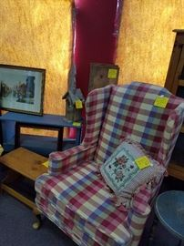 One of several nice upholstered arm chairs and vintage stools, benches, and shelving.